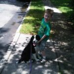 A little kid with his dog